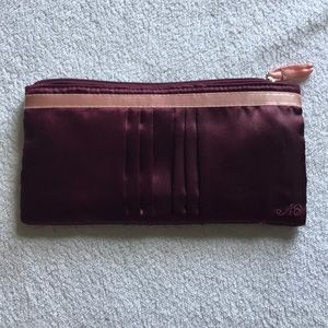 AE purple satin clutch.